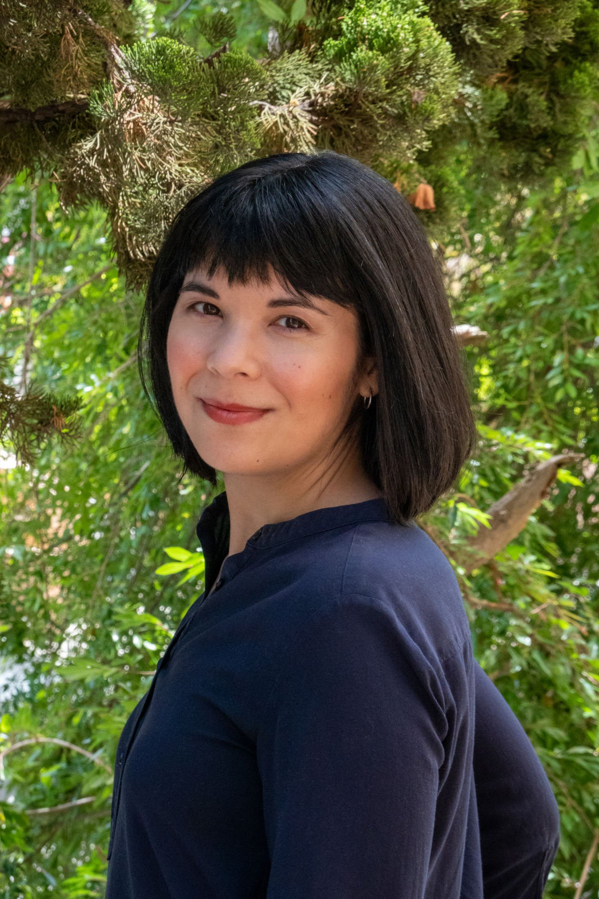 Miyoko Conley Photo with a tree in the background.